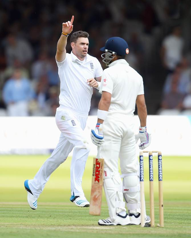 Virat Kohli watches as James Anderson celebrates his dismissal.