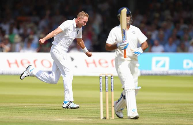 Mahendra Singh Dhoni walks off as Stuart Broad celebrates his dismissal