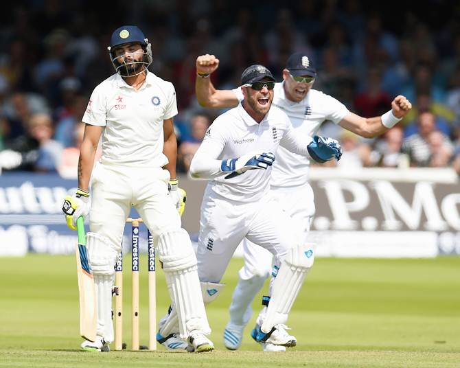 Ravindra Jadeja reacts after being given out lbw as Matt Prior and James Anderson (right) celebrate