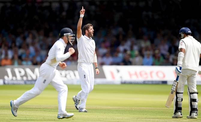England bowler Liam Plunkett celebrates after dismissing Murali Vijay