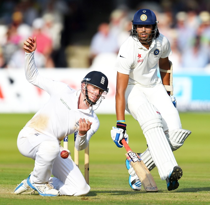 India batsman Ishant Sharma makes his ground despite the efforts of fielder Sam Robson