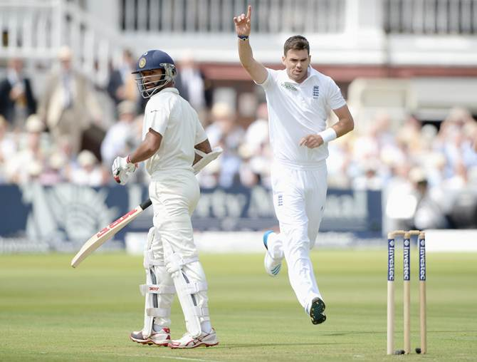 England pacer James Anderson celebrates after dismissing Shikhar Dhawan
