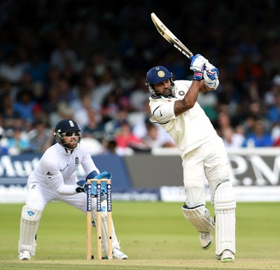 Murali Vijay (right) hits out as Matt Prior looks on