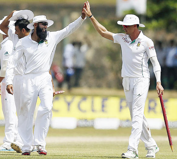 South Africa's captain Hashim Amla (left) and bowler Dale Steyn celebrate after their win in the first Test against Sri Lanka on Sunday