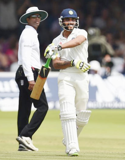Ravindra Jadeja celebrates after completing his half-century