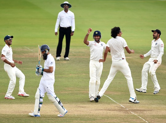 England batsman Moeen Ali walks off after being caught by Cheteshwar Pujara (centre), off bowler Ishant Sharma (second right)