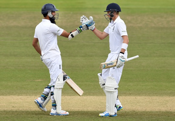 England batsmen Joe Root (right) and Moeen Ali celebrate their century partnership during Day 5