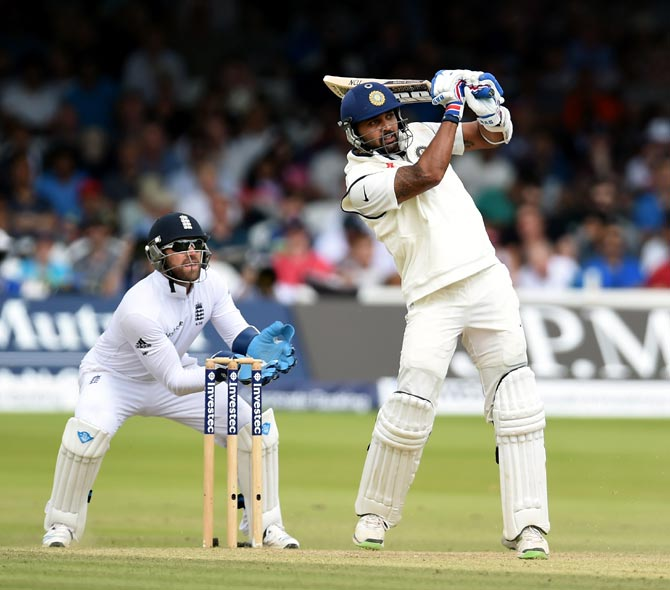 Murali Vijay hits out as England wicketkeeper Matt Prior (left) looks on