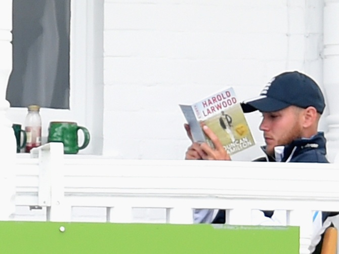 England bowler Stuart Broad settles down to a brew and tucks into a good book