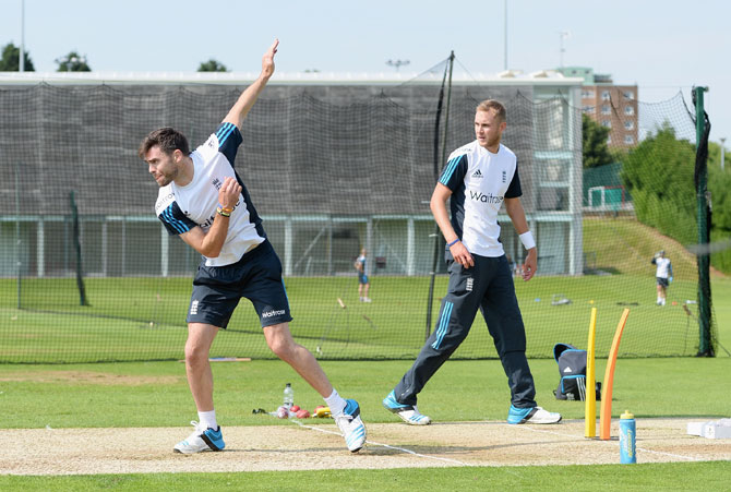 James Anderson bowls watched by Stuart Broad during an England training session
