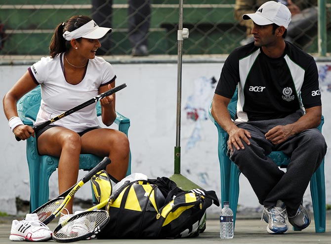 Sania Mirza speaks to her husband Shoaib Malik during a training session