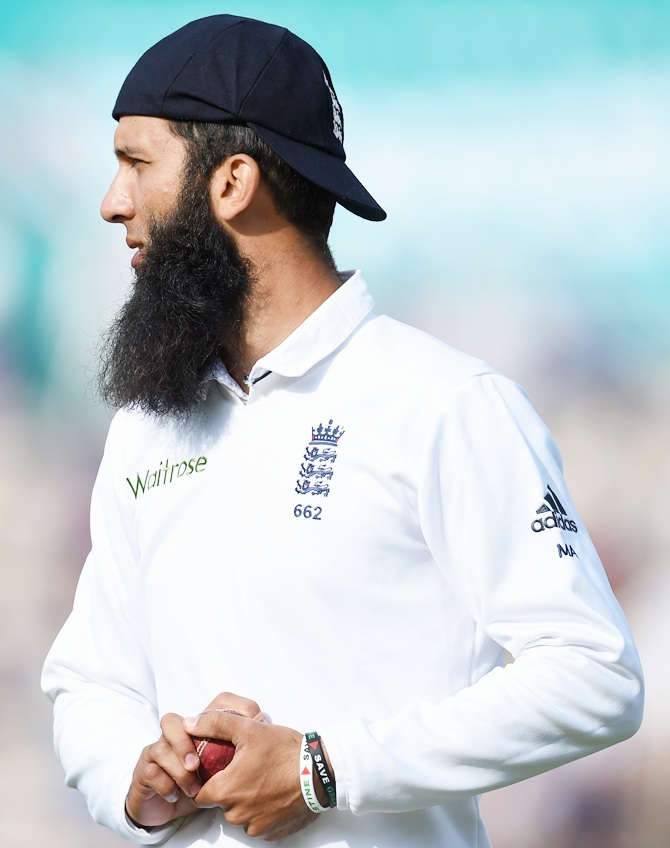England player Moeen Ali looks on whilst wearing his cap back to front during day two