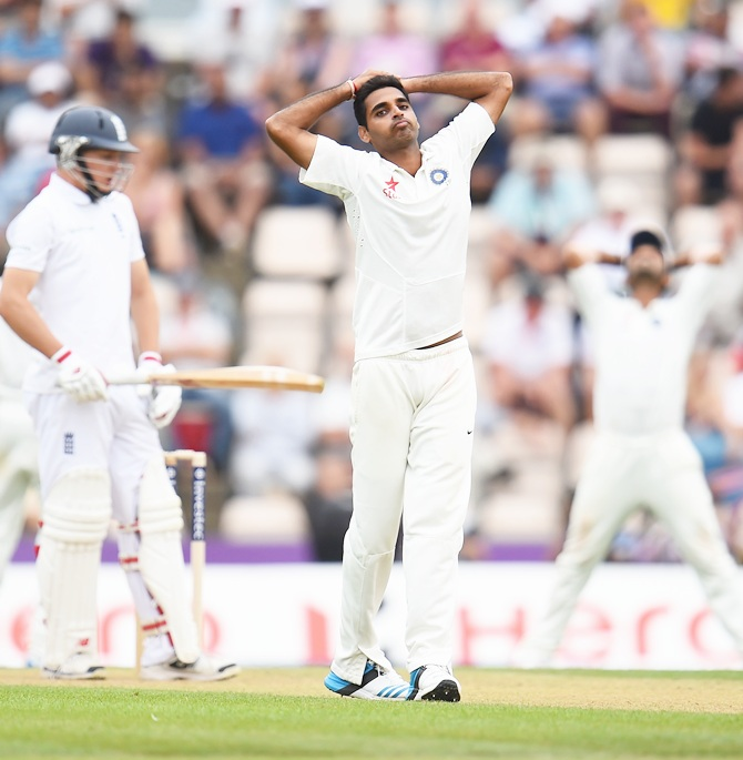 Bhuvneshwar Kumar of India looks dejected as Gary Ballance of England has a lucky escape