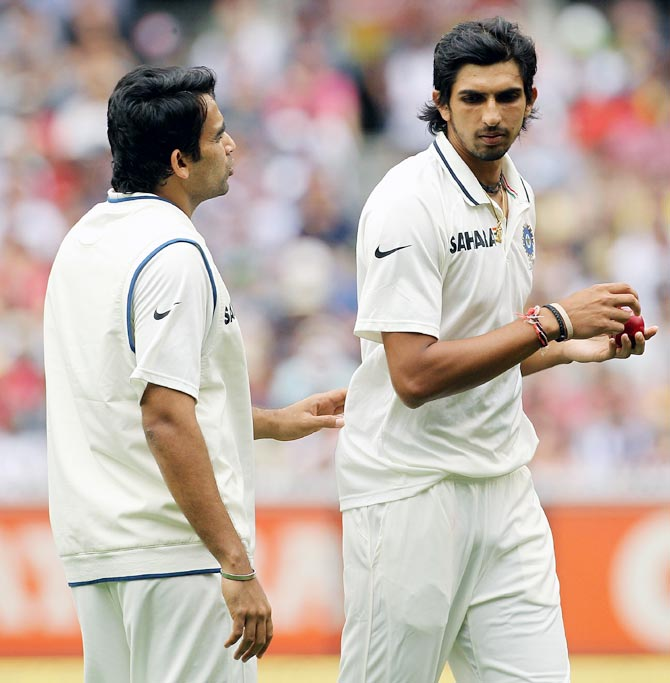 Zaheer Khan, left, advises Ishant Sharma during a Test match.