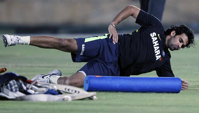 Zaheer Khan stretches during a training session.