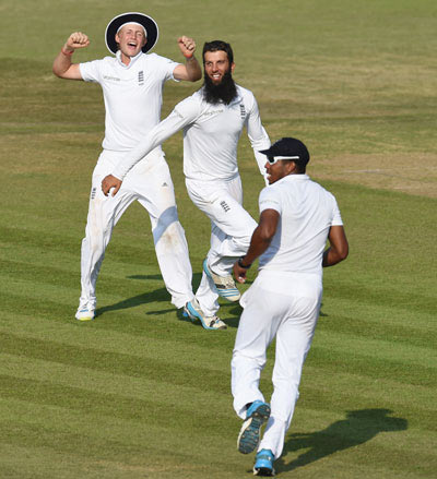 England bowler Moeen Ali celebrates after taking the wicket of India batsman Virat Kohli