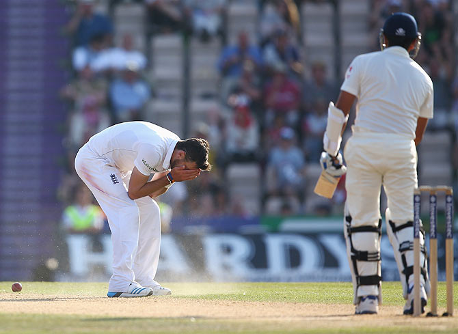 James Anderson reacts after dropping Rohit Sharma off his own bowling on day four of the 3rd Test match on Wednesday