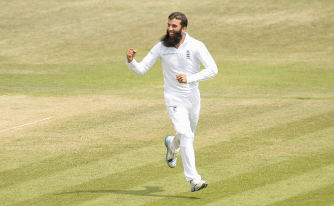 England's Moeen Ali celebrates after dismissing Mohammed Shami during the third Test match against India at the Rose Bowl