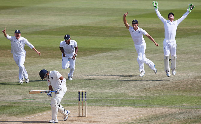 Jos Buttler (right) celebrates after taking a catch to dismiss Rohit Sharma off the bowling of James Anderson on Day 5 of the third Test at the Ageas Bowl in Southampton on Thursday