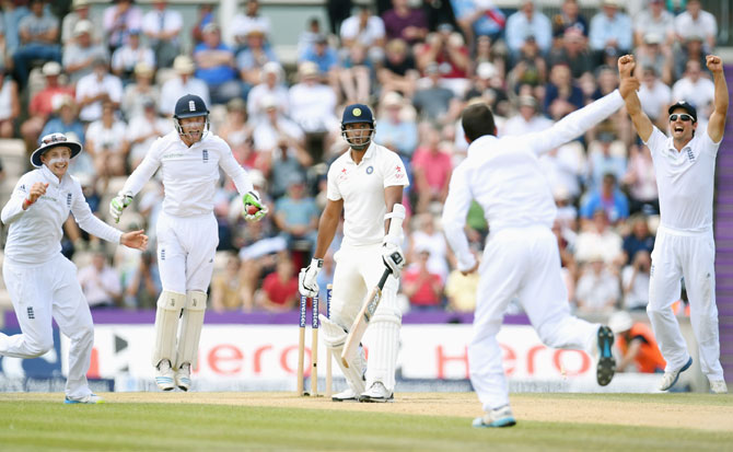England bowler Moeen Ali and captain Alastair Cook (right) celebrate after taking the wicket of India batsman Pankaj Singh to win the match