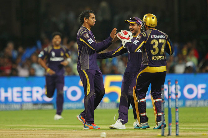 Sunil Narine is congratulated by his Kolkata teammates.