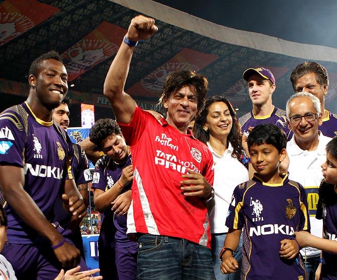 Shah Rukh Khan (centre) celebrates KKR's IPL triumph.