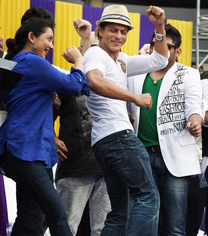 Kolkata Knight Riders owner Shahrukh Khan dances during a felicitation ceremony