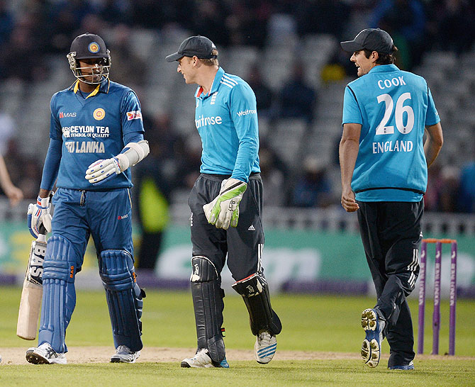 Jos Buttler of England and Angelo Mathews of Sri Lanka exchange words during the  One Day International match on Tuesday