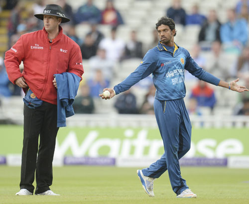 Sri Lanka's Sachithra Senanayake appeals for the run-out of England's Jos Buttler (not in picture) as umpire Michael Gough (left) looks on during the fifth One-Day International at Edgbaston.