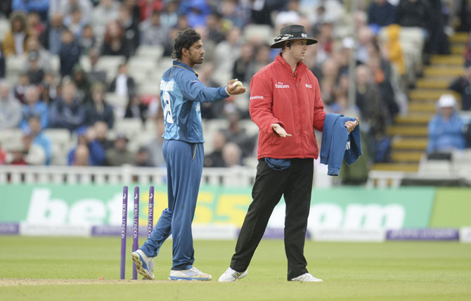 Sri Lanka's Sachithra Senanayake appeals for the run-out of England non-striker Jos Buttler (not in picture) to umpire Michael Gough (right)