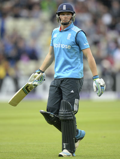England's Jos Buttler leaves the field after declared being run-out.
