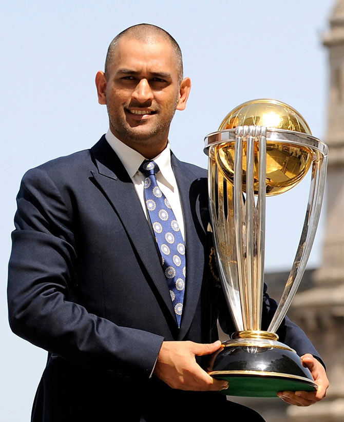 Captain Mahendra Singh Dhoni lifts the trophy at the Taj hotel the day after India defeated Sri Lanka in the ICC Cricket World Cup final in Mumba