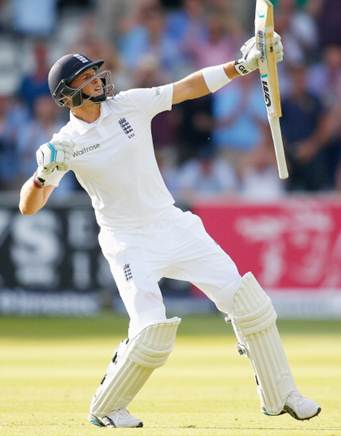 Joe Root celebrates after scoring hundred