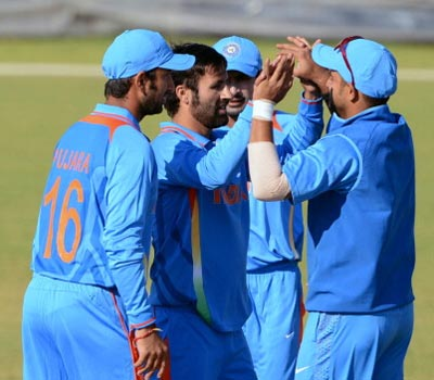 Parveez Rasool celebrates with his teammates