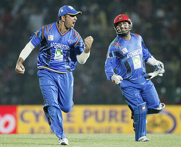 Afghanistan's Samiullah Shenwari (left) and wicketkeeper Mohammad Shahzad celebrate the dismissal of Bangladesh's Nasir Hossain on Saturday
