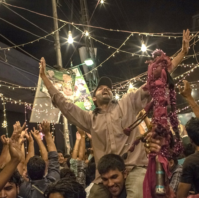 Supporters of Pakistan team celebrate.