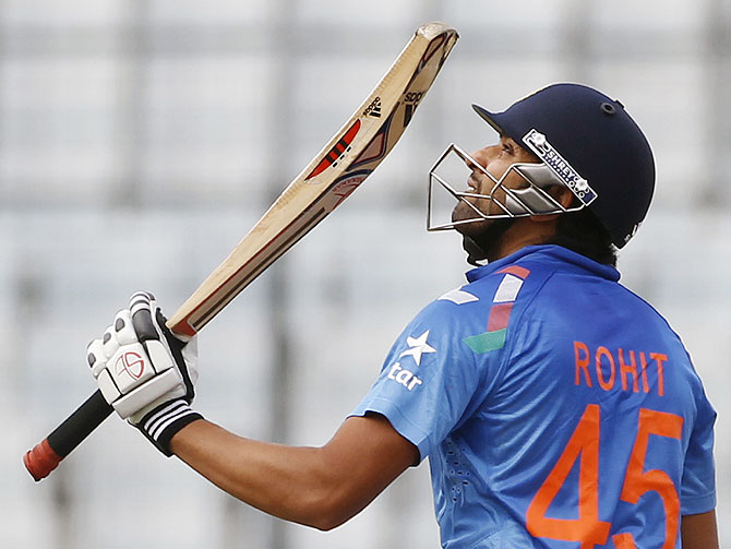 India's Rohit Sharma celebrates after scoring a half century against Pakistan on Sunday