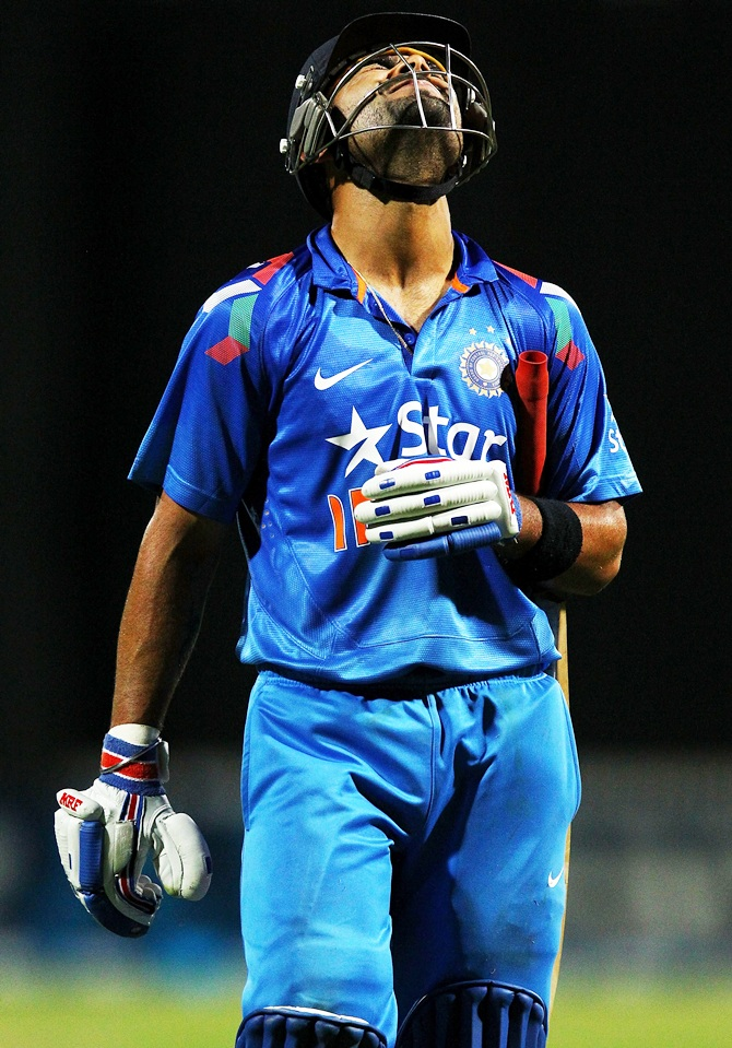 Virat Kohli of India reacts as he leaves the field.
