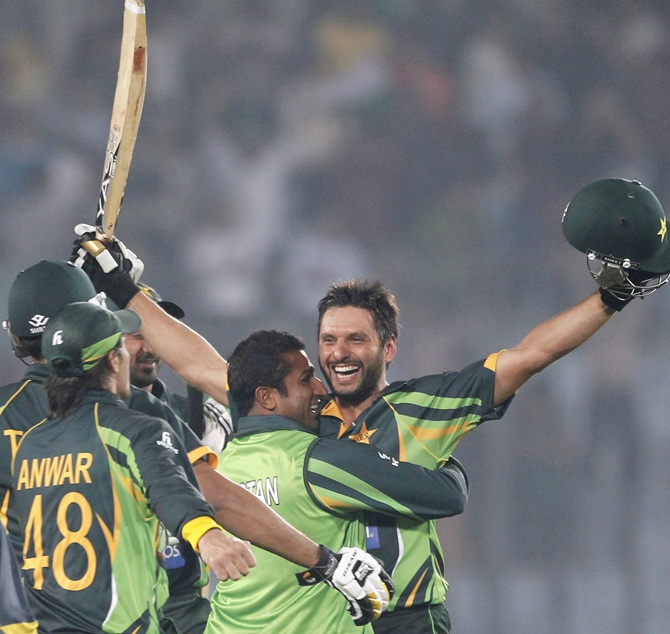 Pakistan's Shahid Afridi,right, celebrates with teammates after Pakistan won the match against India.