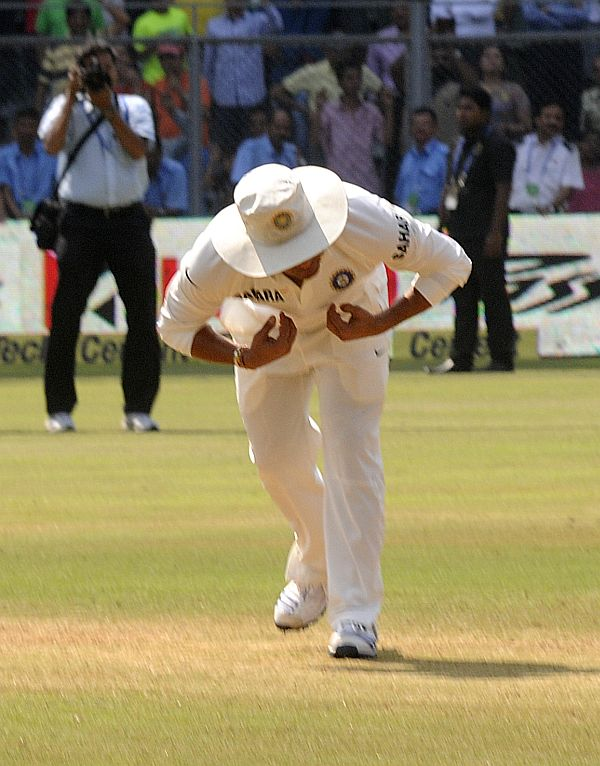 Sachin kisses the pitch before walking off.