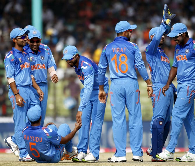 India's players celebrate a wicket during the Asia Cup match against Bangladesh in Fatullah.
