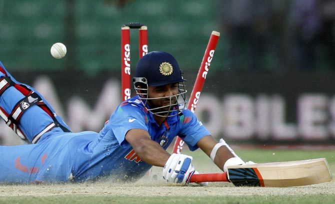 Ajinkya Rahane dives to avoid a run-out