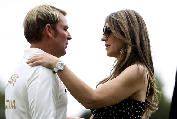 Shane Warne with Elizabeth Hurley in happier times.