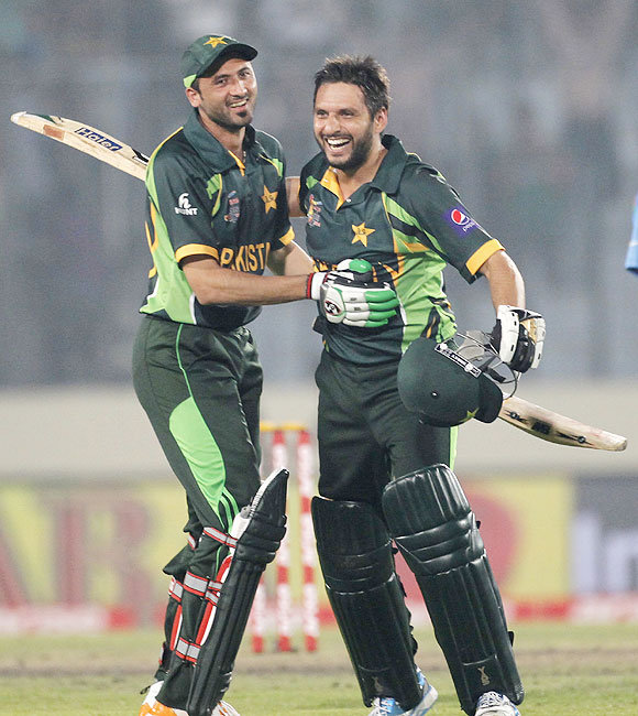 Pakistan's Shahid Afridi and Junaid Khan (left) celebrate after Pakistan won their Asia Cup ODI against India in Dhaka on Sunday
