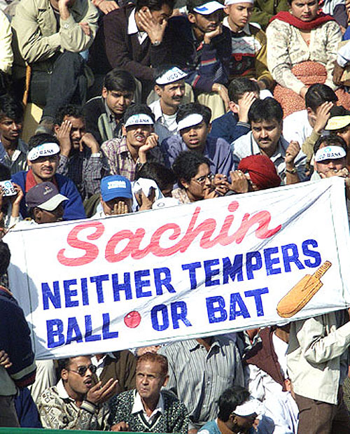 Fans hold a banner during a match in support of Sachin Tendulkar