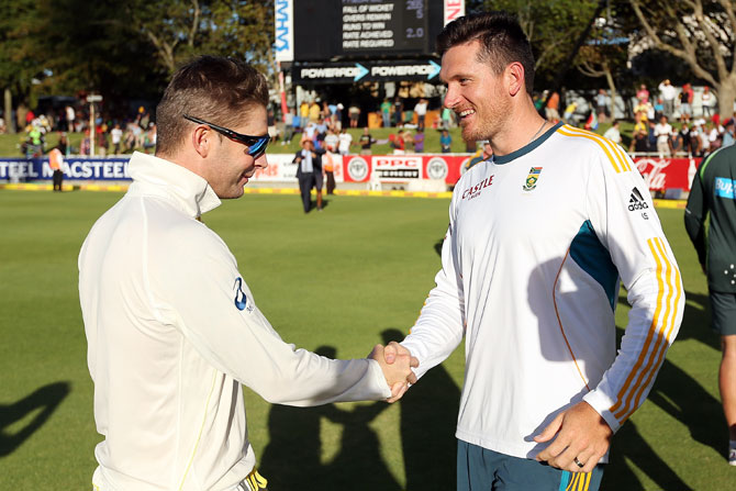Michael Clarke of Australia shakes hands with Graeme Smith of South Africa after the third Test at Sahara Park Newlands