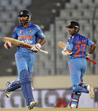India's Shikhar Dhawan (left) and Ajinkya Rahane run between the wickets against Afghanistan in their Asia Cup match in Dhaka