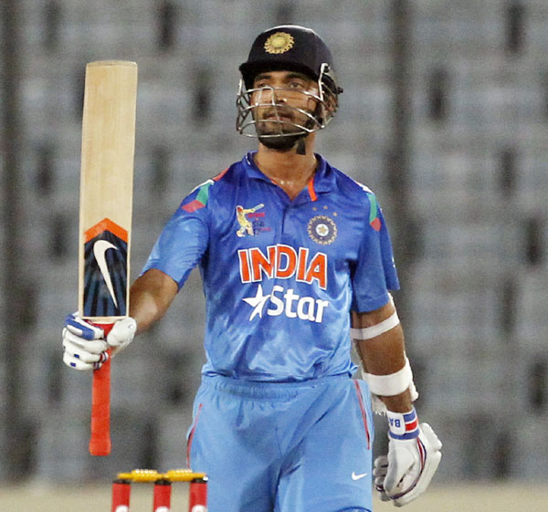India's Ajinkya Rahane celebrates after scoring a half century against Afghanistan