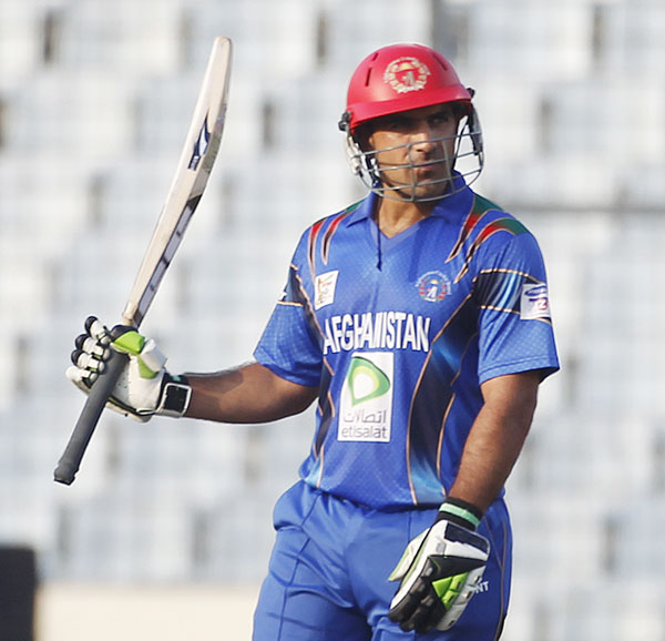 Afghanistan's Samiullah Shenwari celebrates after scoring a half century against India