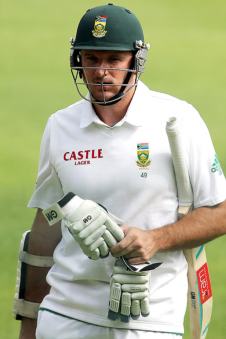 Graeme Smith leaves the field after getting out to Ryan Harris during Day 3 of the third Test between South Africa and Australia at Sahara Park Newlands on March 3, 2014